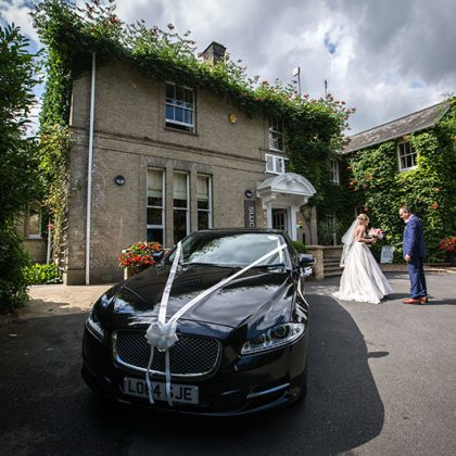 Wedding transport, daughter & father special moment, Milsoms Hotel, Dedham, Essex / Photo: Martin Beard Photography