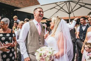 What a joyful groom, High House Weddings, Essex / Photo by: Rebecca Farries Photography