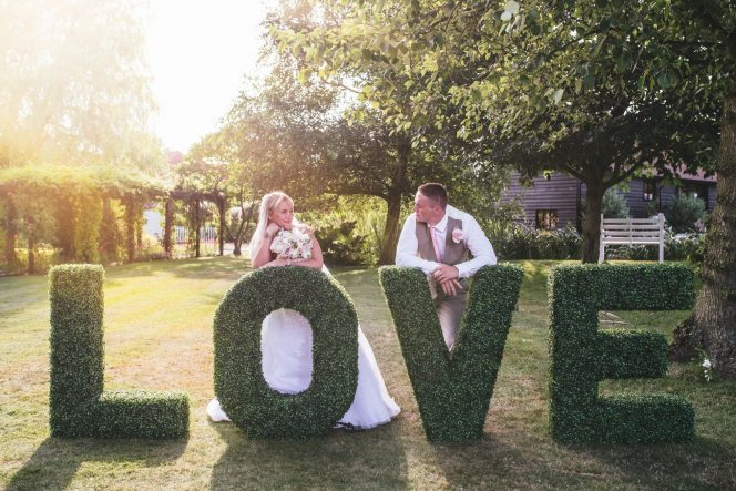 The look of LOVE at High House Weddings with The Prop Boutique / Photo: Rebecca Farries Photography