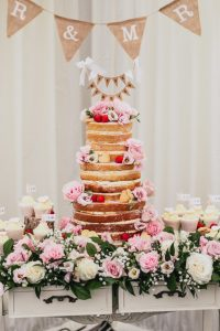Naked Wedding Cake, made by Pinkface Cakes, Essex. Flowers by Poppies Floral Design / Photo: Rebecca Farries Photography