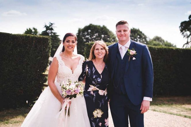 Wedding Planner Mary Briscoe with Happy Couple / Photo by Sophie Oldhamstead Photography